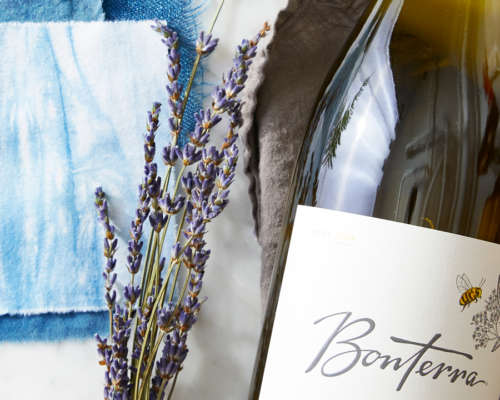Bonterra wine next lavender on a marble table